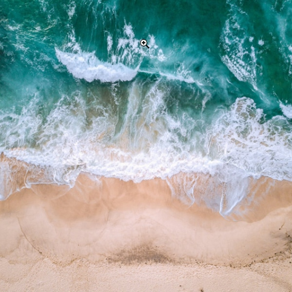 ocean water and sandy beach