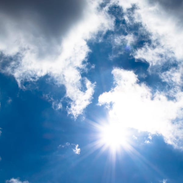 blue sky with clouds and sun shining ozone