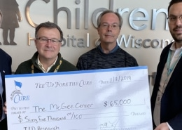 Tee Up Fore the Cure presents a fundraising check of $65,000 to Children's Hospital of Wisocnsin